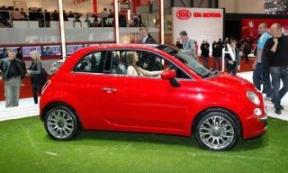 Tire, Motor vehicle, Wheel, Automotive design, Mode of transport, Vehicle, Automotive mirror, Automotive wheel system, Alloy wheel, Red,
