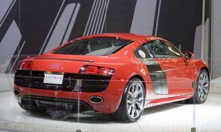 Tire, Automotive design, Vehicle, Red, Car, Grille, Automotive lighting, Fender, Automotive exterior, Bumper,