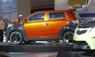 Motor vehicle, Tire, Wheel, Mode of transport, Automotive design, Vehicle, Yellow, Car, Vehicle door, Rim,
