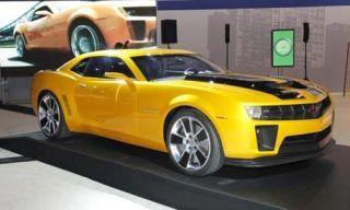 Tire, Wheel, Motor vehicle, Mode of transport, Automotive design, Transport, Vehicle, Yellow, Land vehicle, Alloy wheel,