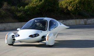 Motor vehicle, Mode of transport, Automotive design, Automotive mirror, Automotive exterior, Photograph, Asphalt, White, Road surface, Car,