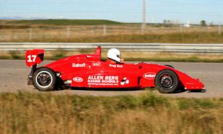 Tire, Automotive design, Mode of transport, Automotive tire, Vehicle, Race track, Red, Motorsport, Car, Automotive wheel system,