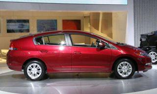Tire, Motor vehicle, Wheel, Mode of transport, Automotive design, Vehicle, Transport, Alloy wheel, Land vehicle, Property,