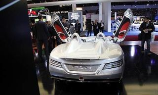 Mode of transport, Product, Automotive design, Event, Car, Technology, Grille, Bumper, Mid-size car, Luxury vehicle,