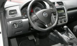 Motor vehicle, Mode of transport, Product, Steering part, Steering wheel, Transport, Automotive design, Photograph, White, Technology,