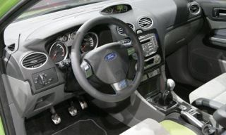Motor vehicle, Steering part, Mode of transport, Automotive mirror, Steering wheel, Product, Transport, Brown, Automotive design, Center console,