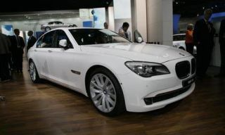 Mode of transport, Automotive design, Photograph, Grille, Alloy wheel, Luxury vehicle, Personal luxury car, Floor, Spoke, Rim,