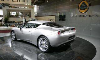 Motor vehicle, Tire, Mode of transport, Automotive design, Vehicle, Yellow, Automotive lighting, Property, Car, Automotive parking light,