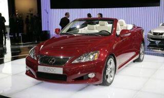 Mode of transport, Automotive design, Vehicle, Event, Automotive mirror, Car, Photograph, Red, Personal luxury car, Automotive lighting,