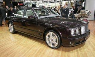 Tire, Mode of transport, Wood, Vehicle, Car, Hardwood, Luxury vehicle, Grille, Personal luxury car, Alloy wheel,