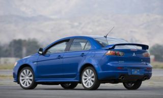 Tire, Wheel, Mode of transport, Automotive design, Blue, Vehicle, Product, Land vehicle, Automotive mirror, Car,