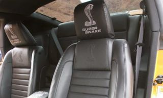 Motor vehicle, Mode of transport, Transport, Photograph, White, Car seat, Head restraint, Black, Grey, Car seat cover,