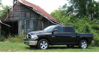Tire, Motor vehicle, Wheel, Automotive tire, Natural environment, Vehicle, Transport, Glass, Window, Rim,
