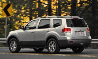 Tire, Wheel, Motor vehicle, Mode of transport, Automotive tire, Road, Automotive mirror, Vehicle, Automotive tail & brake light, Rim,