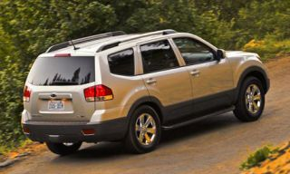 Tire, Wheel, Motor vehicle, Automotive tire, Vehicle, Rim, Road, Infrastructure, Car, Alloy wheel,