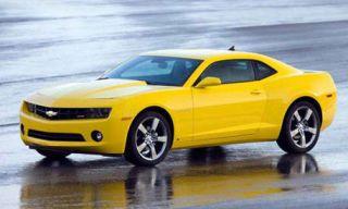Tire, Motor vehicle, Wheel, Mode of transport, Automotive design, Automotive tire, Transport, Yellow, Vehicle, Hood,