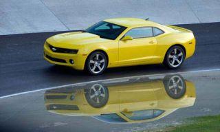 Tire, Motor vehicle, Wheel, Mode of transport, Automotive design, Transport, Vehicle, Yellow, Road, Land vehicle,