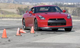 Tire, Automotive design, Cone, Vehicle, Land vehicle, Road, Infrastructure, Red, Hood, Car,