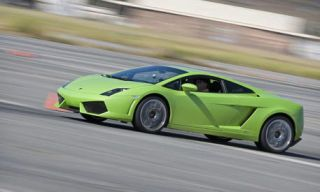 Tire, Wheel, Motor vehicle, Mode of transport, Automotive design, Road, Transport, Yellow, Vehicle, Rim,