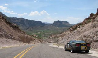 Motor vehicle, Mountainous landforms, Road, Mode of transport, Nature, Highland, Mountain range, Asphalt, Automotive parking light, Hill,