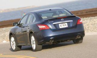 Tire, Motor vehicle, Mode of transport, Vehicle, Car, Vehicle registration plate, Photograph, White, Automotive tire, Rim,
