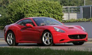 Tire, Wheel, Mode of transport, Automotive design, Vehicle, Red, Performance car, Car, Photograph, Rim,