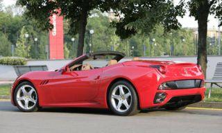 Tire, Motor vehicle, Wheel, Mode of transport, Automotive design, Vehicle, Transport, Property, Infrastructure, Red,