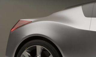 Motor vehicle, Wheel, Automotive design, Automotive tire, Alloy wheel, Automotive exterior, Rim, Automotive wheel system, Automotive lighting, White,