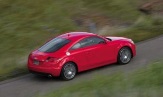 Tire, Wheel, Mode of transport, Automotive design, Vehicle, Road, Land vehicle, Car, Red, Automotive mirror,