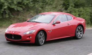 Tire, Mode of transport, Vehicle, Automotive design, Red, Car, Performance car, Photograph, Rim, White,