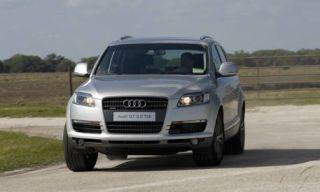Motor vehicle, Tire, Road, Mode of transport, Automotive mirror, Automotive design, Transport, Daytime, Vehicle, Vehicle registration plate,