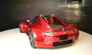 Motor vehicle, Mode of transport, Automotive design, Vehicle, Transport, Automotive exterior, Red, Automotive tire, Rim, Automotive wheel system,