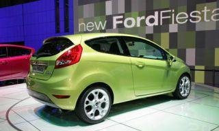 Tire, Motor vehicle, Automotive mirror, Wheel, Mode of transport, Automotive design, Yellow, Transport, Vehicle, Land vehicle,