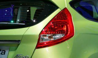Motor vehicle, Automotive tail & brake light, Yellow, Automotive lighting, Automotive design, Car, Red, Hatchback, Fender, Automotive exterior,