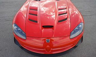 Mode of transport, Automotive design, Hood, Red, Automotive exterior, Supercar, Sports car, Pink, Bumper, Grille,