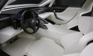 Motor vehicle, Mode of transport, Steering part, Steering wheel, Photograph, White, Car seat, Luxury vehicle, Black, Center console,