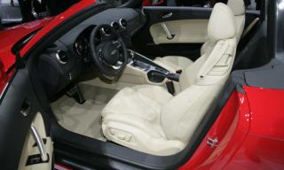 Motor vehicle, Mode of transport, Steering part, Vehicle, Steering wheel, Automotive design, Car, White, Red, Car seat,