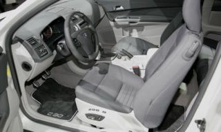 Motor vehicle, Mode of transport, Automotive design, Steering part, Steering wheel, White, Car, Luxury vehicle, Personal luxury car, Center console,