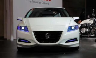 Mode of transport, Automotive design, Product, Vehicle, Event, Transport, Car, Photograph, Automotive mirror, White,