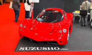 Motor vehicle, Mode of transport, Automotive design, Vehicle, Red, Automotive lighting, Car, Automotive exterior, Fender, Automotive mirror,