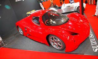 Motor vehicle, Mode of transport, Automotive design, Red, Automotive exterior, Alloy wheel, Car, Rim, Automotive wheel system, Fender,