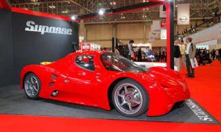 Tire, Motor vehicle, Mode of transport, Automotive design, Vehicle, Red, Car, Automotive wheel system, Automotive tire, Rim,
