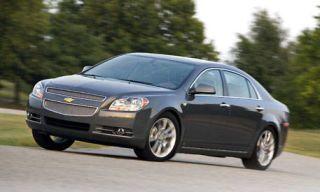 Tire, Wheel, Motor vehicle, Automotive mirror, Mode of transport, Automotive design, Automotive tire, Vehicle, Transport, Automotive lighting,