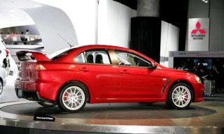 Tire, Wheel, Automotive design, Mode of transport, Vehicle, Alloy wheel, Car, Rim, Red, Technology,