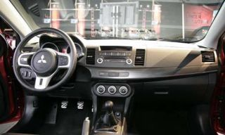 Motor vehicle, Mode of transport, Product, Transport, Steering part, Automotive design, Property, Car, Photograph, Steering wheel,