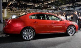 Tire, Motor vehicle, Wheel, Mode of transport, Automotive design, Vehicle, Land vehicle, Alloy wheel, Car, Red,
