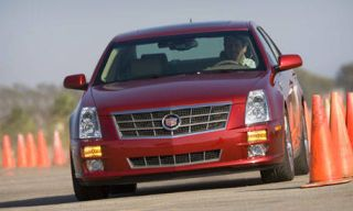 Motor vehicle, Mode of transport, Transport, Daytime, Vehicle, Automotive design, Automotive lighting, Automotive mirror, Infrastructure, Red,