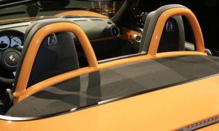 Motor vehicle, Mode of transport, Automotive design, Yellow, Transport, Steering wheel, Steering part, Automotive mirror, Vehicle door, Fixture,