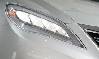 Automotive design, Automotive exterior, White, Automotive lighting, Headlamp, Light, Personal luxury car, Tints and shades, Black, Grey,