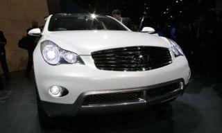 Motor vehicle, Mode of transport, Automotive design, Automotive mirror, Automotive lighting, Transport, Vehicle, Headlamp, Grille, Hood,